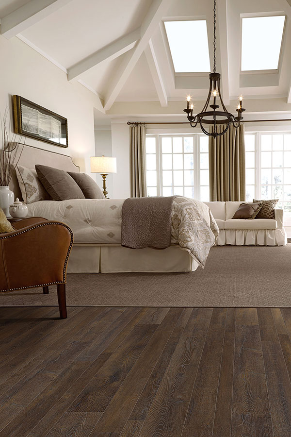 Bedroom with Brown Laminate Flooring